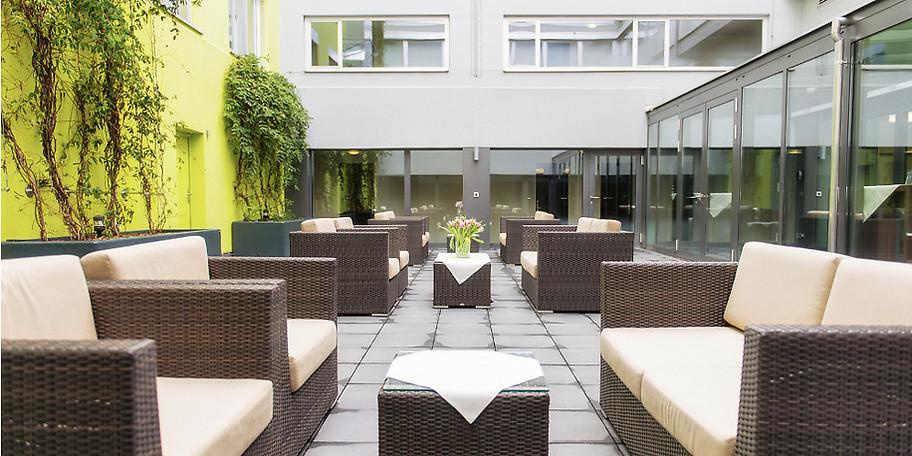 Entspannen Sie in unserem Wintergarten